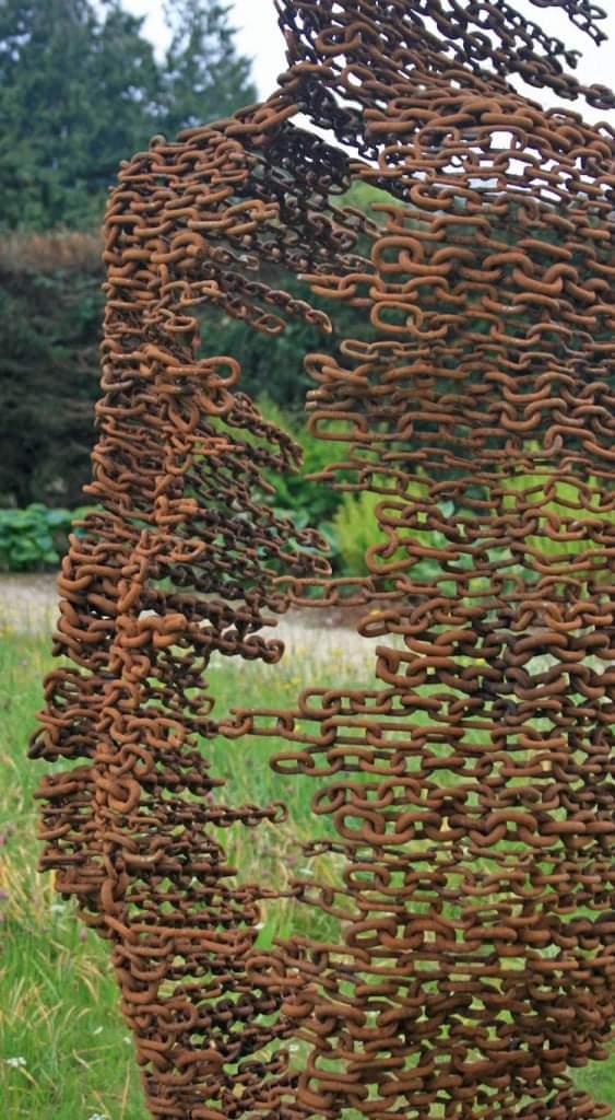 Artist Uses Recycled Metal To Create Human Figures