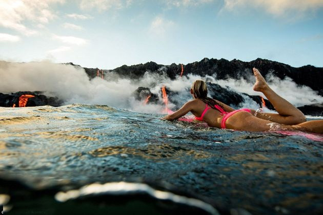 STUNNING MOMENT: This Adventure Seeking Woman swims near lava during volcanic eruption